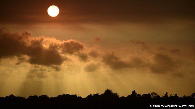 Red sun in a hazy sky