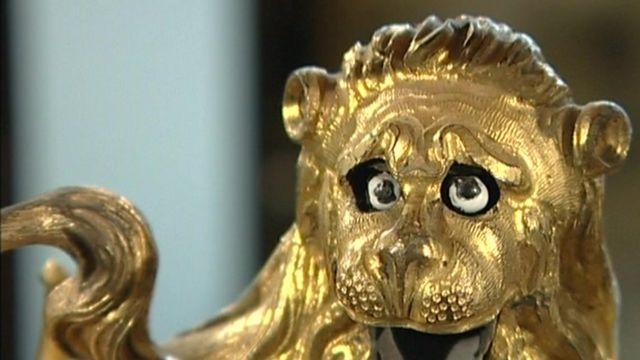 Lion detail on an antique clock