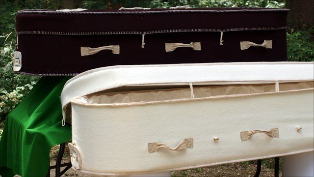 Burial park manager Fran Hall has a look at some of the coffins on display at the National Coffin Exhibition