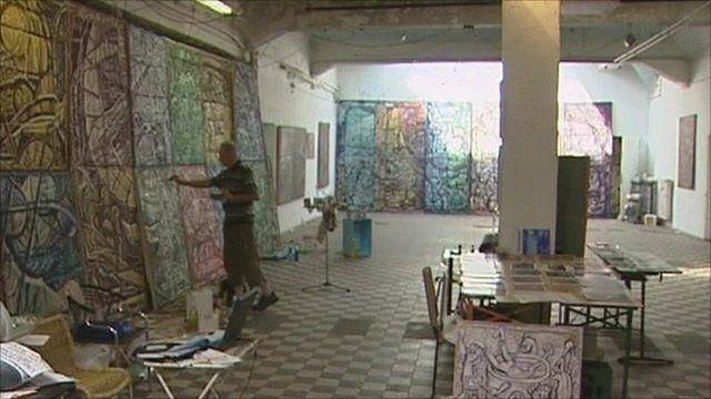 Artist Alexander Rodin paints in the Tacheles arts centre