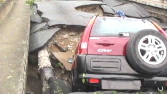 Car in wrecked road
