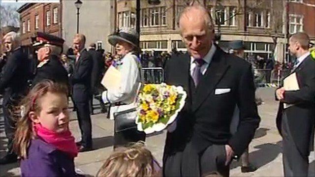 Prince Philip greeting children
