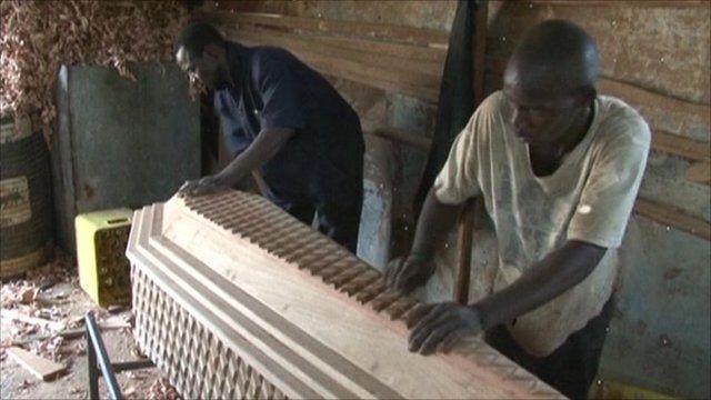 Men making a coffin in Sierra Leone