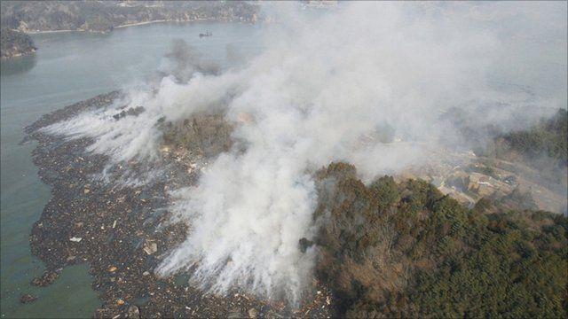 Smoke rises after earthquake and tsunami hit Kesennuma City