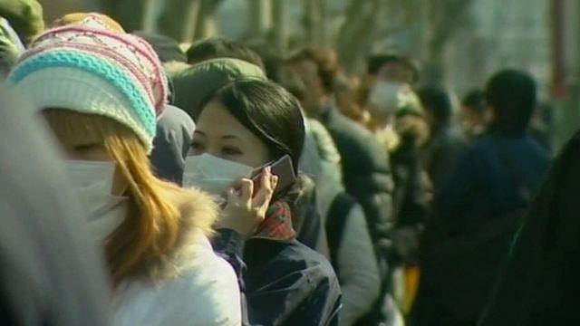 People queuing in Tokyo