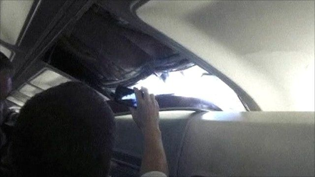 Passengers capture footage of the hole in the plane roof