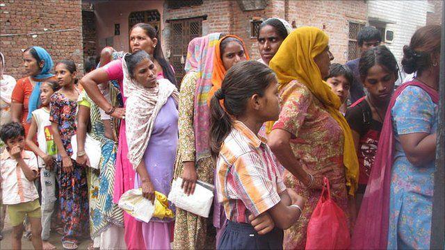 Women queue up to buy subsidised food