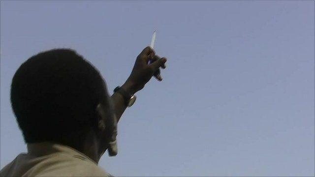 Man watching for strikes in Sudan