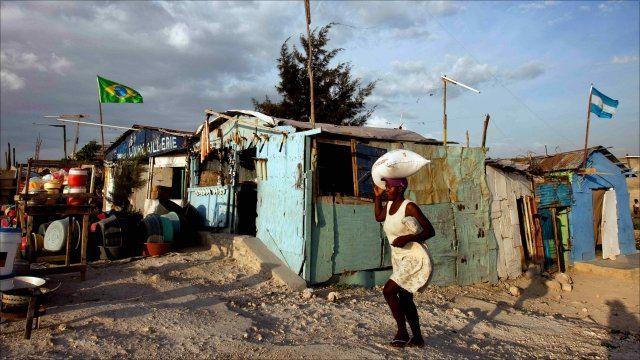 A woman walking in Port Au Prince, Haiti