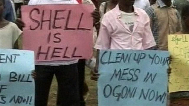 People with anti-Shell posters