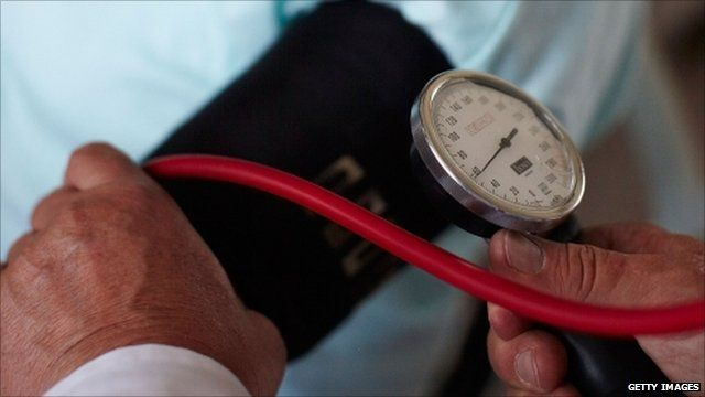 Blood pressure being checked