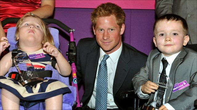 Prince Harry poses with 5-year-old Sophie Cooper (left) from Lincoln and 6-year-old Harley Lane from Stockport