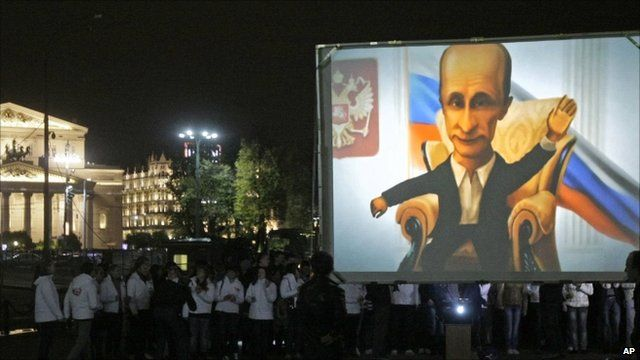 Members of a pro-Kremlin youth movement gather in front of a screen to wish PM Vladimir Putin a happy birthday