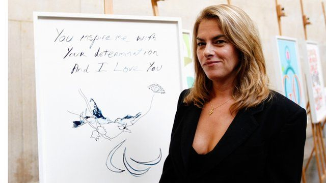 Tracey Emin poses with her poster