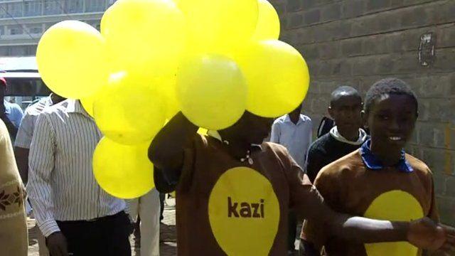 Volunteers give yellow balloons away in Nairobi