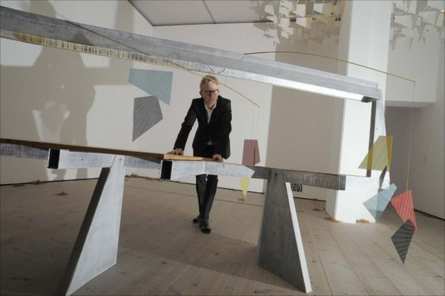 """Martin Boyce poses with his work """"Do Words Have Voices"""""""