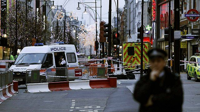 Policeman standing on Oxford Street
