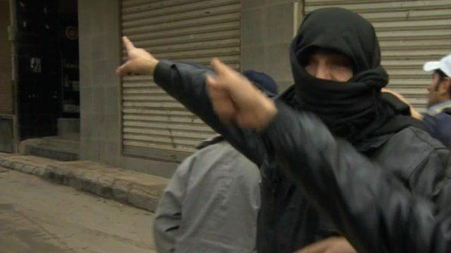 Men in street in Syria