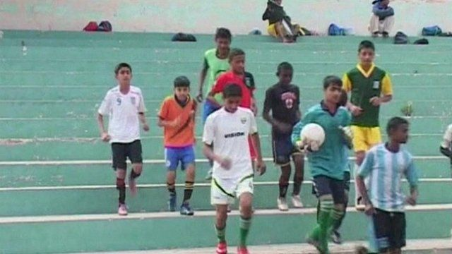 Boys playing football in Karachi