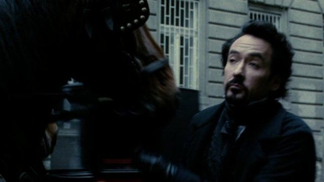 John Cusack in a scene from The Raven