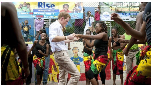 Prince Harry dances with Chantol Dorner during a visit to the Rise Life charity project in Jamaica