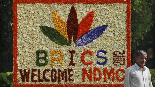 A sign made of fresh flowers with the BRICS Summit logo on it in New Delhi, India.