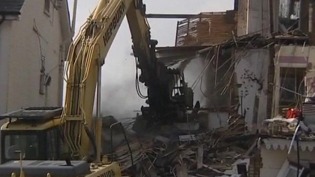 House being demolished by digger