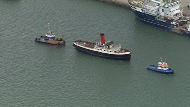 The tug Calshot leading a flotilla away from berth 44 where Titanic was