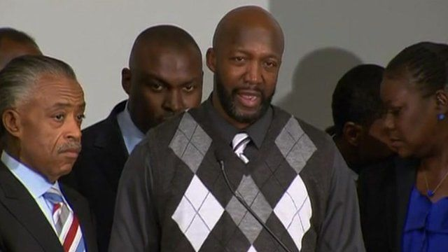 Tracy Martin reacts to the news that his son's shooter is charged with second degree murder 11 April 2012