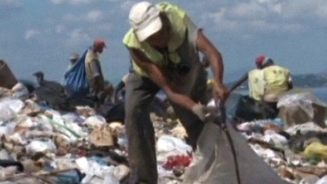 Rubbish scavengers working at landfill