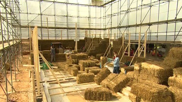 Houses of straw under construction