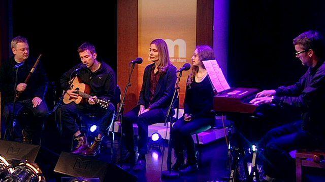 Damon Albarn with musicians