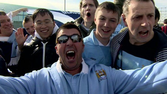 Manchester city fan celebrating