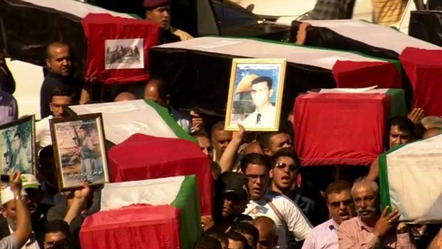 Coffins draped in Palestinian flags