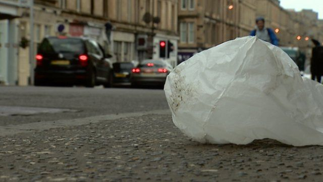 A discarded plastic bag lying in a street