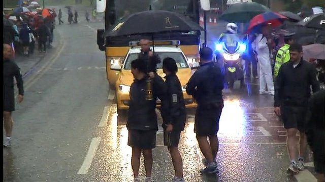 Olympic torch staff halt the relay due to lightning