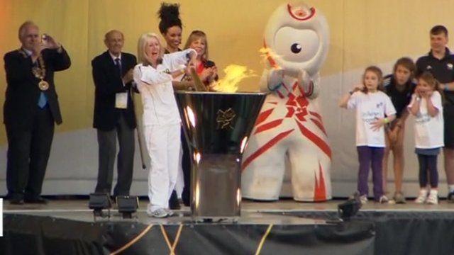 Caroline 'Dolly' Burnett lights the Olympic cauldron in Salisbury