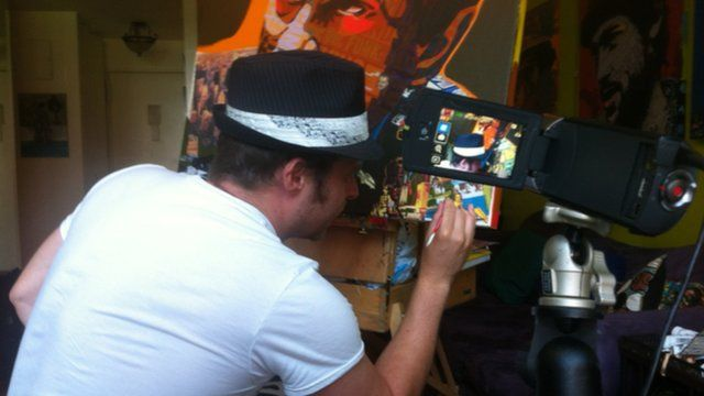A New York City painter filming himself while working