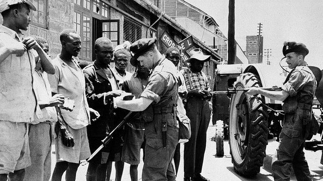 Soldiers of Britain's Royal Inniskilling Fusiliers check the identity of men during a raid on parts of Nairobi, Kenya, on 5 October 1953, looking for Mau Mau members