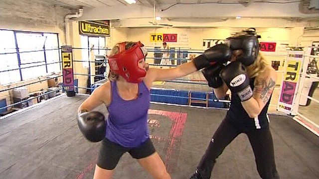 Female boxers sparring in a ring