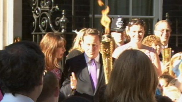 David Cameron and Olympic torch