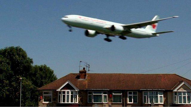 Plane flying over Myrtle Avenue near Heathrow