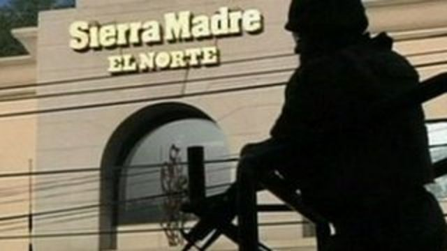 A soldier in front of Sierra Madre, the local branch of El Norte newspaper, which was attacked on Sunday