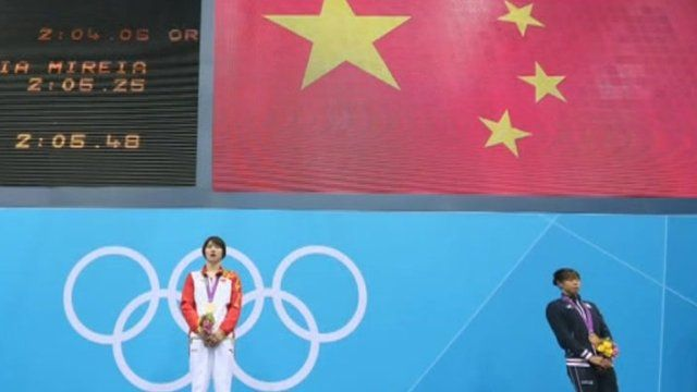 An athlete from China on the podium