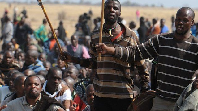 South African miners at the Marikana mine (image from 18 August 2012)