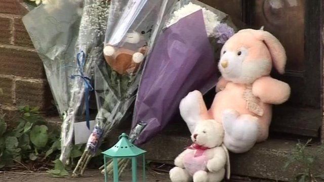 Toys and flowers left at the Cecil family home in Kettering