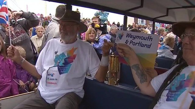 Weymouth greets Paralympic flame ahead of sailing events