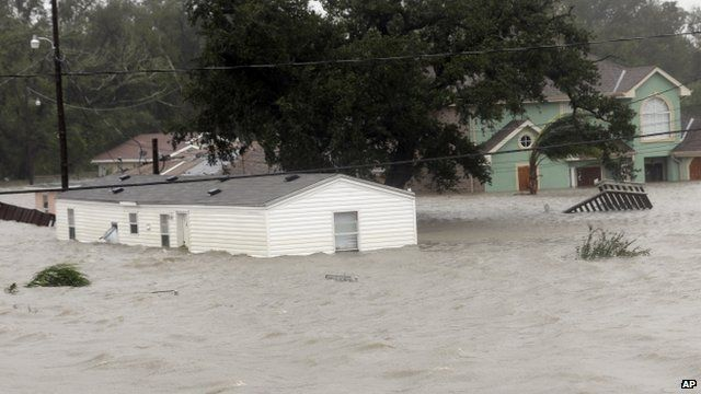 Homes are flooded as Hurricane Isaac hits Wednesday, Aug. 29, 2012, in Braithwaite