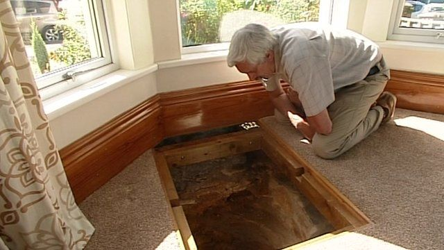 Colin Steer looks down the well in his home in Plymouth