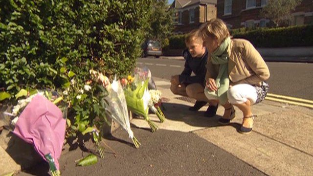 Fiona Horan and her son Dominic pay tribute to the dead street cleaner